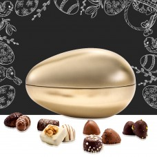 Golden ostrich egg with luxury chocolate